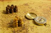 Compass and Chess on old map — Stock Photo