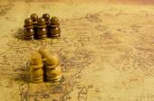 Chess on old map — Stock Photo