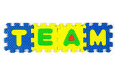 """Color alphabet jigsaw on white background in word """"Team"""" — Stock Photo"""