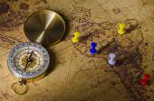 Compass with marked location on old map — Stock Photo