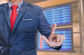 Business man hand touching virtual screen on blur background — Stock Photo