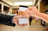 Hand holding a blank smart card on blur background — Stock Photo