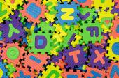 Color Alphabet Jigsaw Puzzle as background — Stock Photo