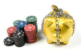 Stack of poker chips and locked gold piggy bank — Stock Photo