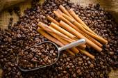 Roasted coffee beans in bag and coffee beans around — Stock Photo