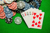 Playing cards 'Full House' and chips on green background — Stock Photo