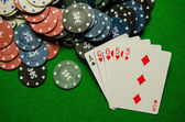 Playing cards 'High card' and chips on green background — Stock Photo