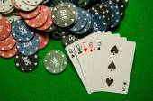 Playing cards 'One pair' and chips on green background — Stock Photo