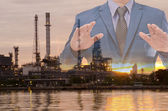 Double exposure of business man and oil refinery background — Stock Photo