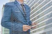 Business man holding tablet in hand in blur background — Stock Photo