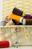 Miniature climbers on spools of threads — Stock Photo