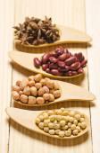 Beans in wooden spoon on wood table — Stock Photo