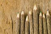 Wooden pencils on wood background — Stock Photo