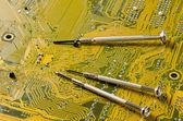 Screwdriver on circuit board — Stock Photo