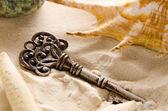 Lost treasure key on sand — Stock Photo