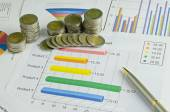 Stack of money coins on graph , business concept — Stock Photo