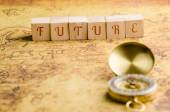 Wood cubes with word Future on an Old Map — Stock Photo