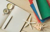 Blank paper with pencil and compass on sea-shells background — Stock Photo