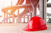 Safety helmet in construction site — Stock Photo