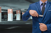Business man hand holding knife on unsafe zone background — Stock Photo