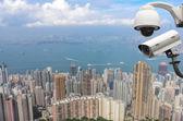 Surveillance Security Camera or CCTV over city — Stock Photo