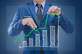 Business man try to bring graph up , business concept — Stock Photo