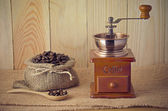 Coffee grinder on wooden table — Stock Photo