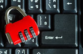 Red metal security lock on keyboard — Stock Photo