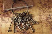 Treasure key on old map — Stock Photo