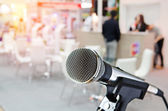 Microphone with blurred event background — Stock Photo