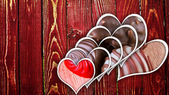 Chocolate pralines on wood — Stock Photo