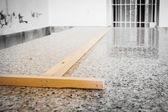 Wood on granite — Stock Photo