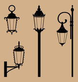 Black lanterns isolated on beige — Stockvector