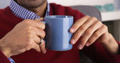 Closeup on a Mexican man's hands holding mug — Stock Photo