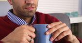 Closeup of man holding mug — Stock Photo
