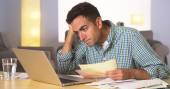 Mexican man feeling frustrated with bills — Photo