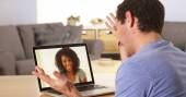 Man webcamming with friend on laptop — Stock Photo