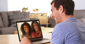 Diverse friends videochatting on laptop — Stock Photo