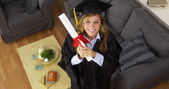 Happy young woman graduate holding diploma — Foto de Stock