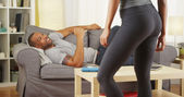 Black couple having a conversation in the living room — Stock Photo