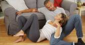 Affectionate black couple talking on floor — Stock Photo