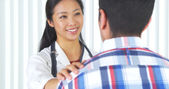 Chinese doctor telling patient the good news — Stock Photo