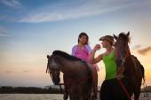 Vacation Lifestyles. Couple Horseback Riding at Sunset — Stock Photo