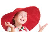 Little girl in a red hat portrait. Isolated on white — Stockfoto