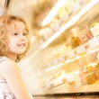 Young girl selection of cakes in the bakery section — Fotografia Stock  #56903463
