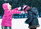 Adorable Little Girls Playing in the Snow Together — Foto Stock