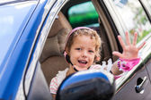 Young girl driving daddys car — Stok fotoğraf