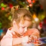 Little child solving a puzzle — Stock Photo #56962919