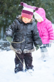 Adorable Little Girls Playing in the Snow Together — Stock Photo