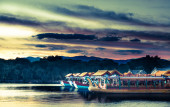 Traditional boats is a lakeside pavilion on the grounds of the Summer Palace in Beijing, China — Stock Photo